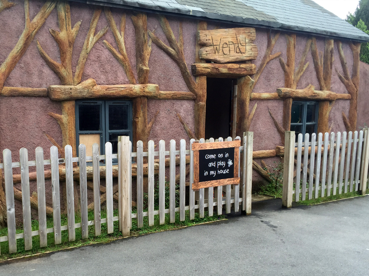 Theme park pink and wooden beams wendy house