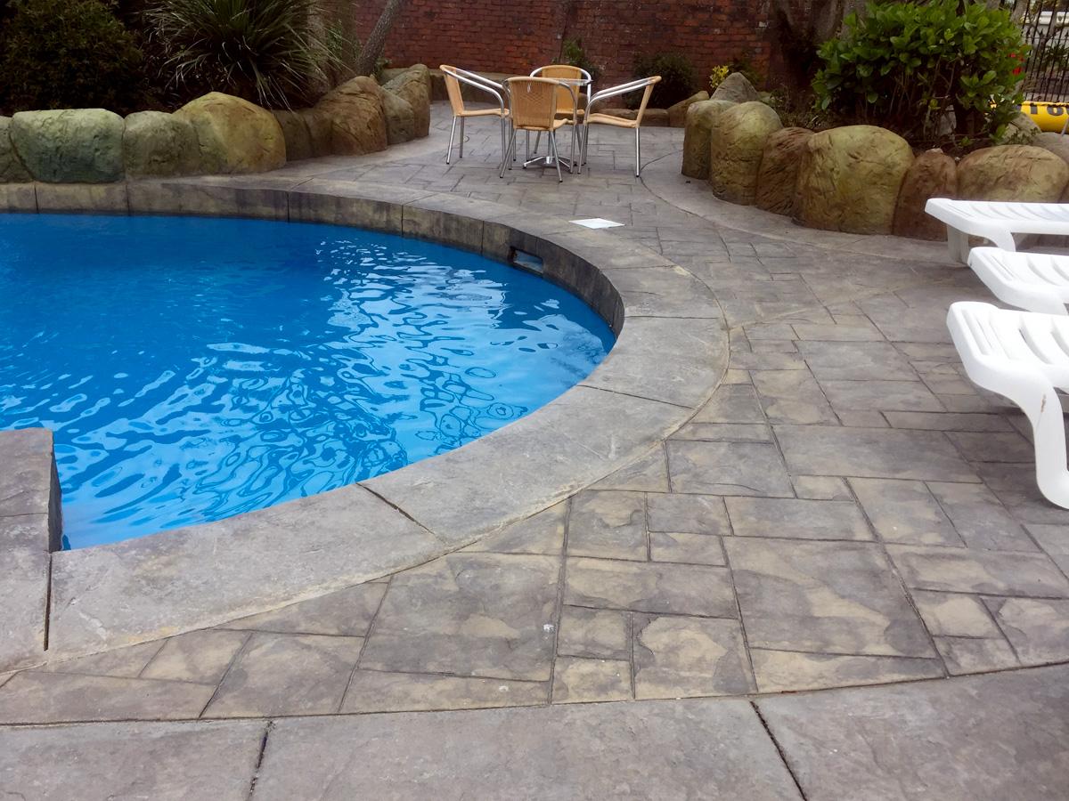 imprinted concrete paving around pool