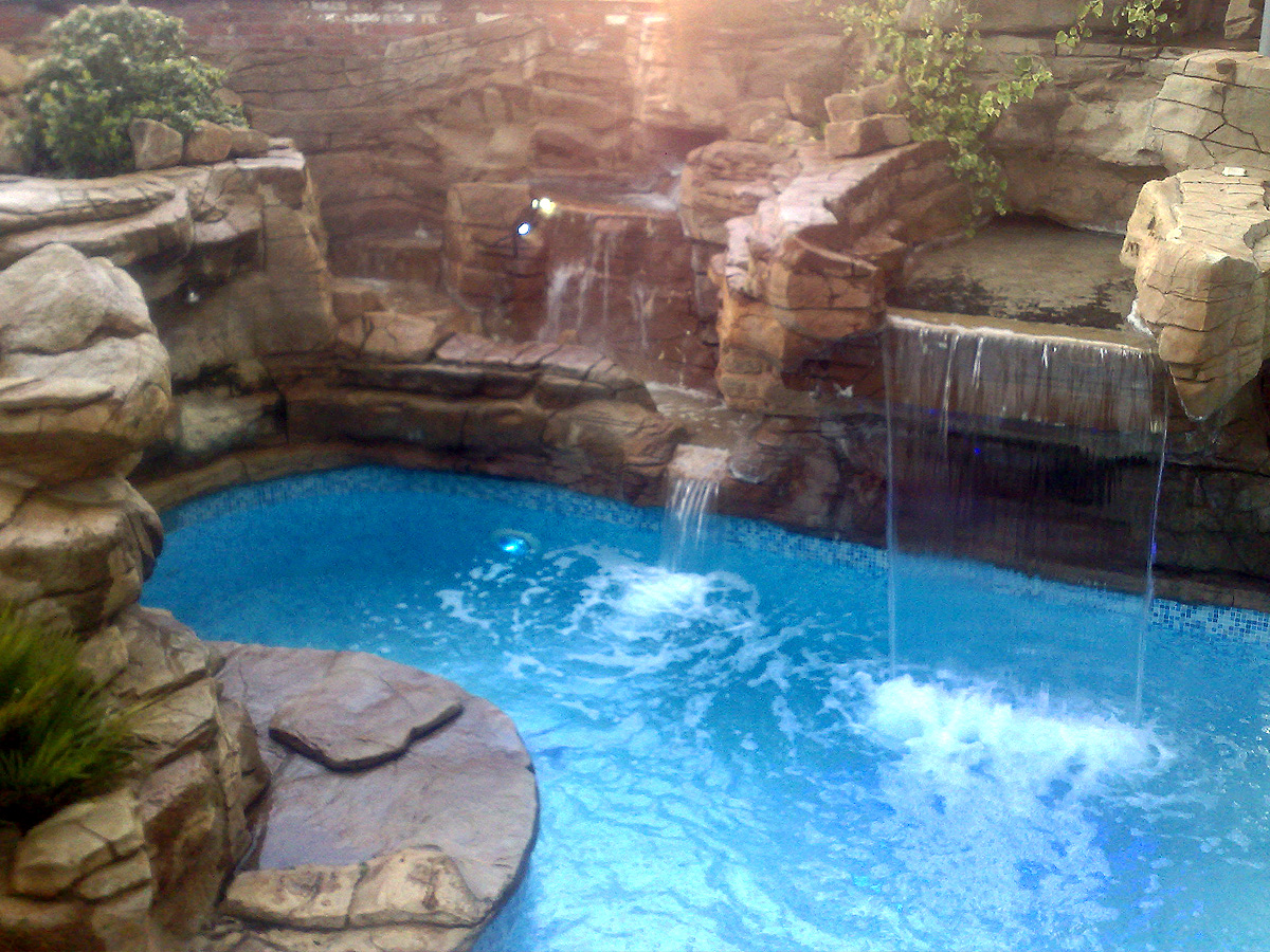Concrete Theming Of Rocks Around A Waterfall Pool